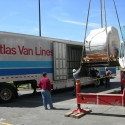 Hoisting a high-value MRI radiology machine onto one of our trailers
