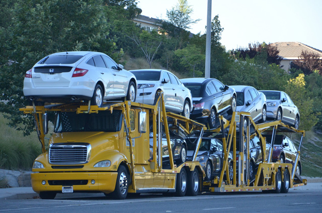 Moving automobiles on a car carrier tractor-trailer