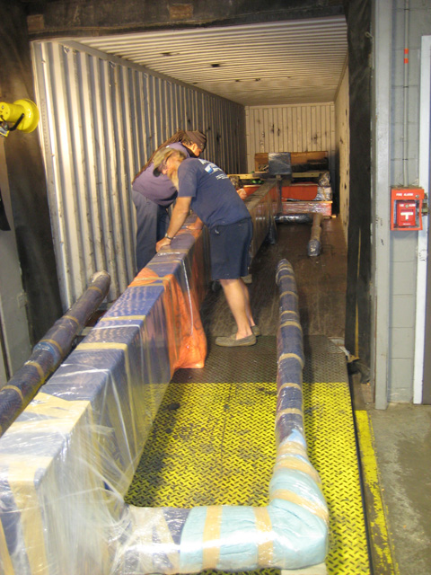 Loading art exhibit into ocean freight containers