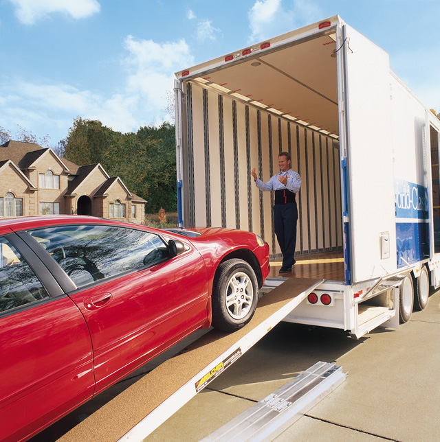 Loading a vehicle on an enclosed trailer