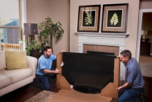 Atlas packers packing a big-screen television