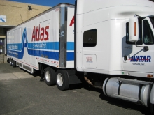 Newly painted Avatar air-ride tractor trailer ready at the loading dock