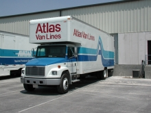 Aatlas Van Lines straight truck moving van ready at the loading dock