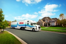 An Atlas Van Lines tractor-trailer moving van