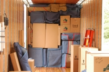 Household goods loaded tight and secure in our moving trailer