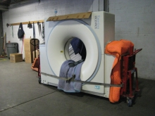 Moving a CT Scanner with roll-a-lifts