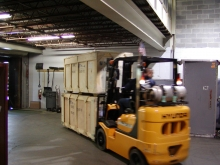 Moving trade show crates inside our warehouse