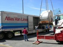 Moving an MRI medical radiology medical machine onto an Atlas trailer