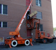 Moving digital telephone equipment into a 2nd floor equipment entry door
