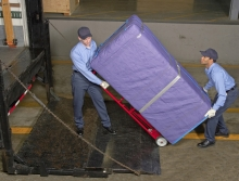 Moving an pad-wrapped cabinet using a Maxon railgate