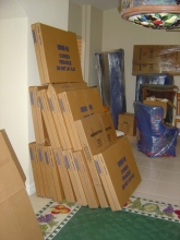 Packed mirror, picture, glass-top cartons stacked and ready to load
