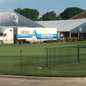 Delivering exhibit material to a PGA golf event
