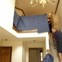 Moving a packed mattress carton down a set of stairs