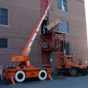 Moving and hoisting digital telephone equipment into a 2nd floor equipment entry door