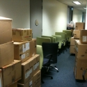 Office contents staged up on dollies and ready to be rolled to the trucks