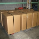 Triwall containers which have been packed and are ready to be shipped via air freight carrier